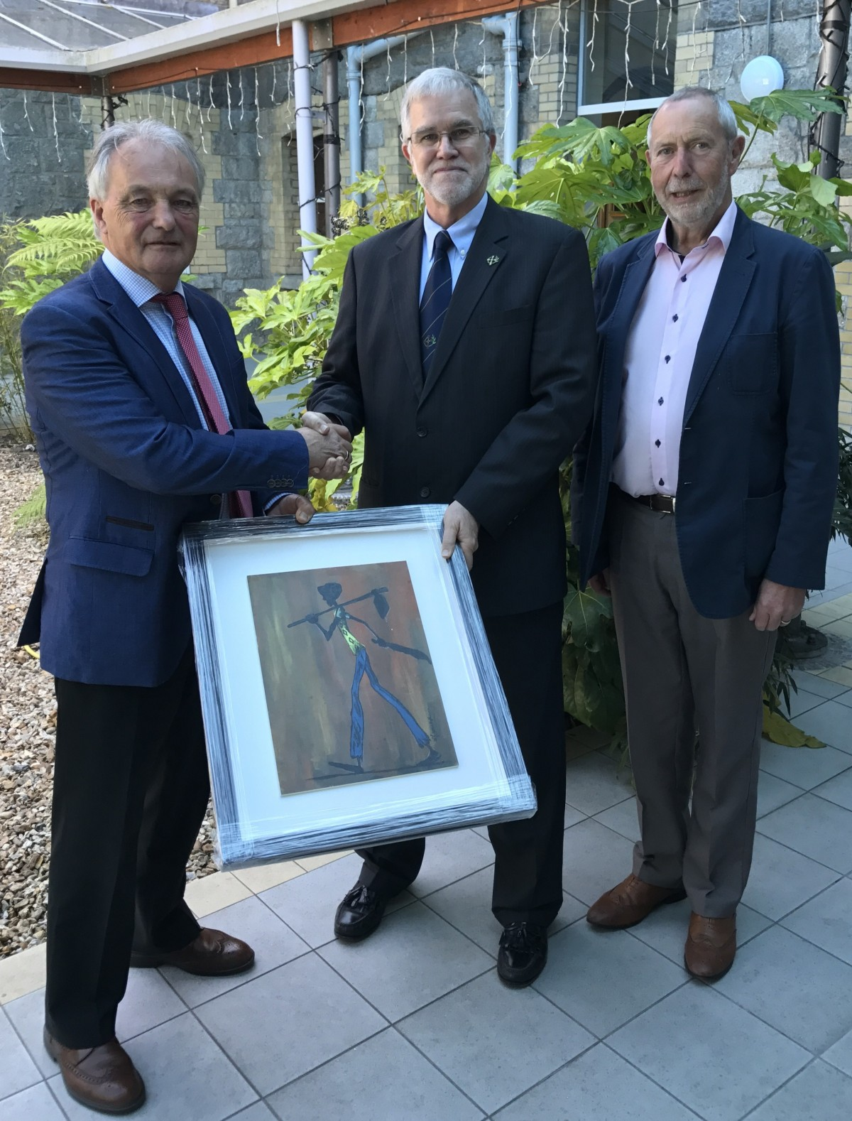 Br. Hugh O'Neill, Congregation Leader presents a painting from the Ruben Centre, Kenya to Matt Breen (pictured left) on the occasion of his retirement as chair of Edmund Rice Development.