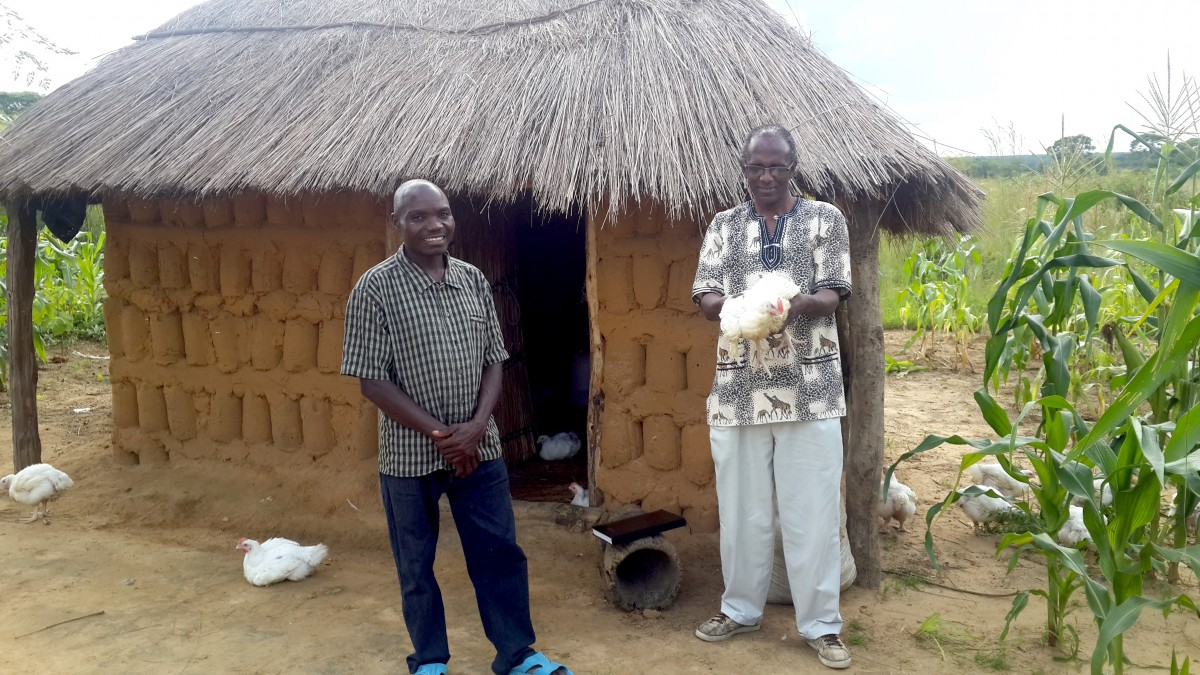 Martin, Right, pictured with a Farmer in Luampa