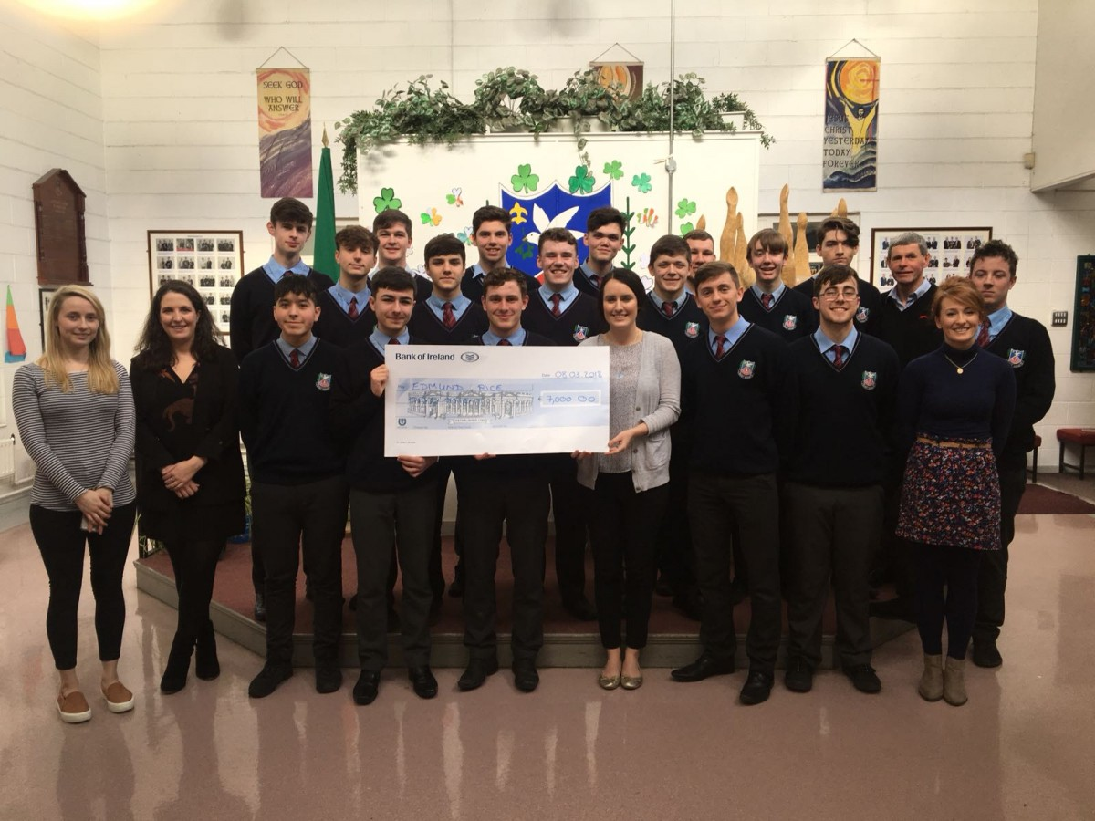 St. Aidan's CBS students and teachers presenting cheque to Edmund Rice Development